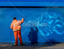 stock-photo-13517145-washing-graffiti-off-a-security-grill