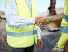 stock-photo-17703140-successful-handshake-deal-at-construction-site